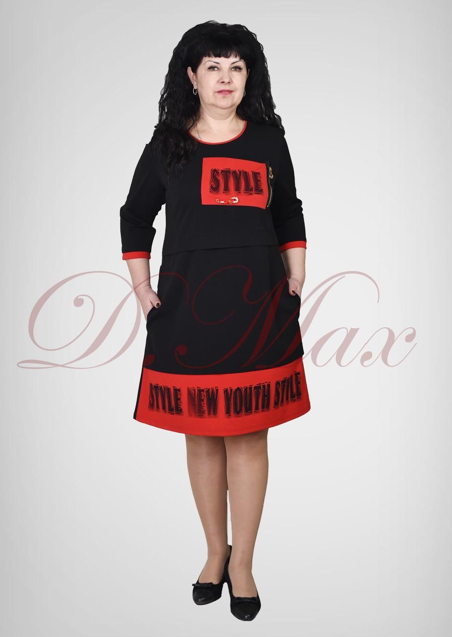 Платье из трикотажа с накладной деталью